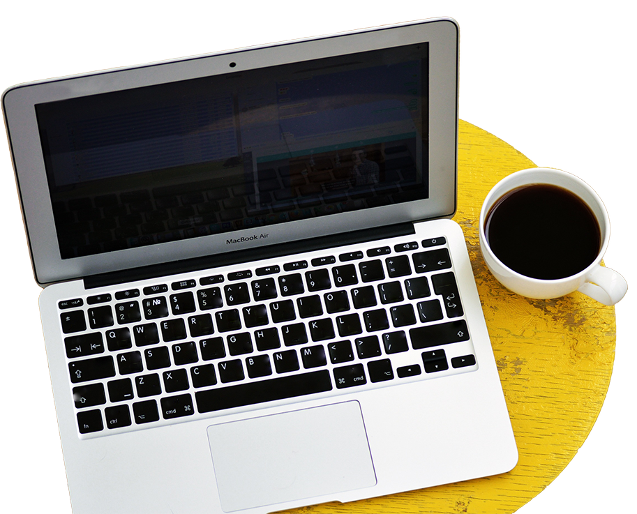 Computer with cup of coffee, part of a digital marketing strategy